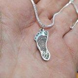 Voetafdruk doodgeboren baby in zilver