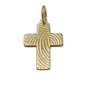 Gouden kruis met vingerafdruk