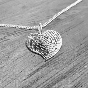 Zilveren hartje met vingerafdruk